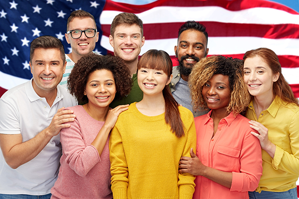Group of people in front of the American flag